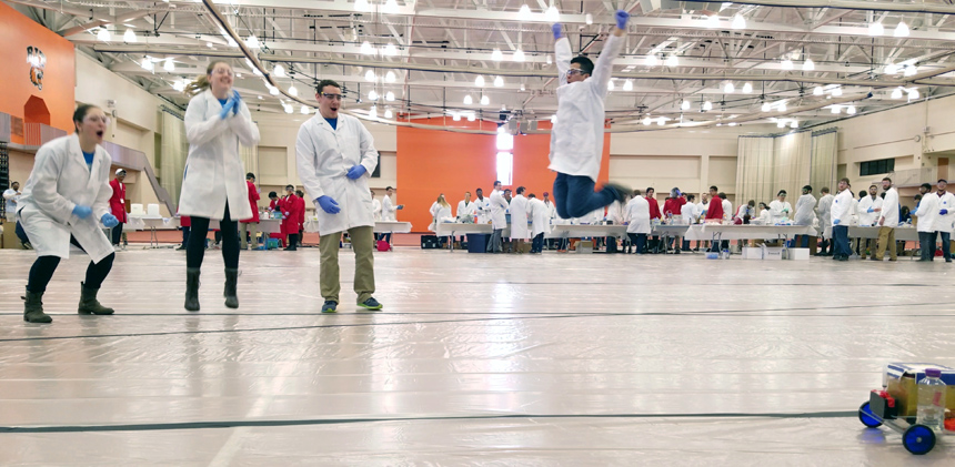 Chem-E-Car team members jump for joy at regional competitiion.