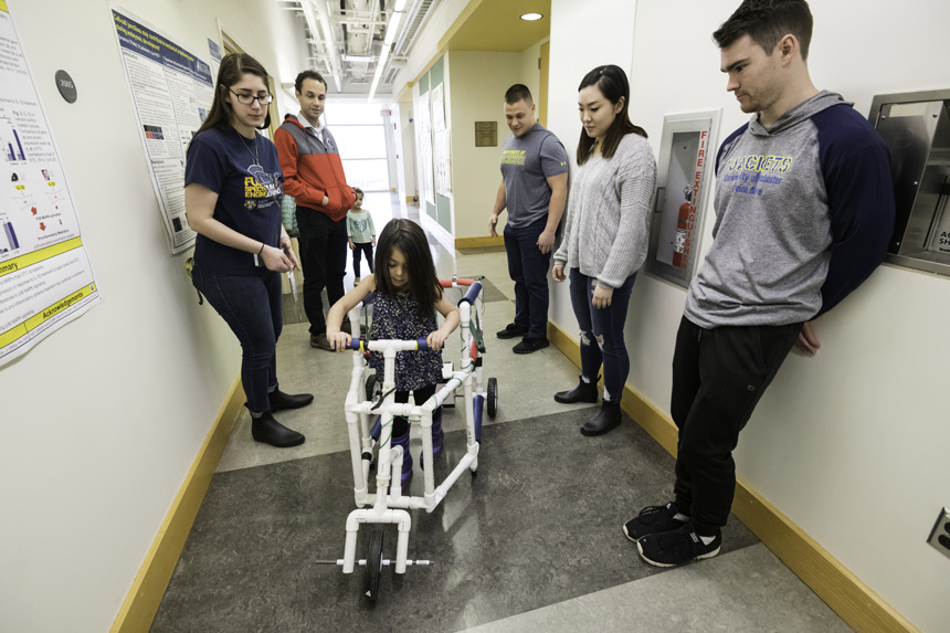 students test device to help disabled chlldren keep up with their peers while also benefiting therapeutically.