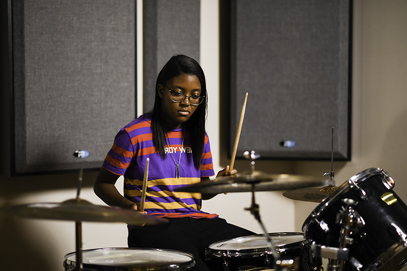 Sanaa Finley plays the drums
