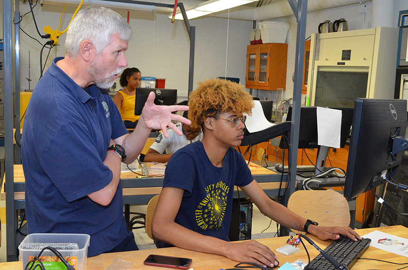 Scott Russell assists student with arduino project